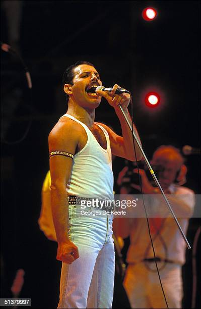 Singer Freddie Mercury of Queen performs during Live Aid at Wembley Stadium on 13 July 1985