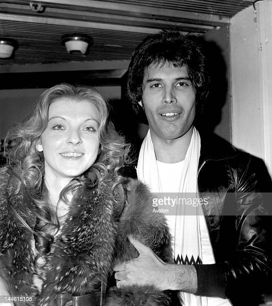 Singer Freddie Mercury of Queen photographed in September 1977 with his girlfriend Mary Austin