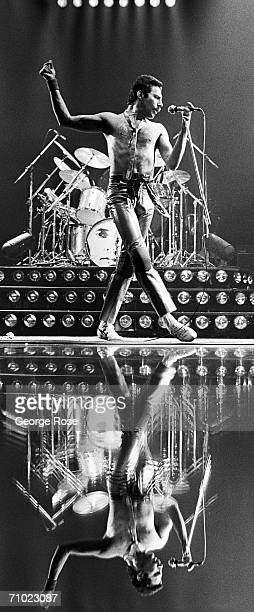 Singer Freddie Mercury of the popular rock group Queen is reflected in the stage flooring during a 1978 concert at the Sports Arena in San Diego...
