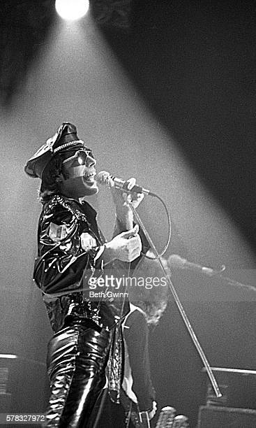 Singer Freddie Mercury of the rock and roll band Queen performs onstage wearing a leather suit on November 22 1978