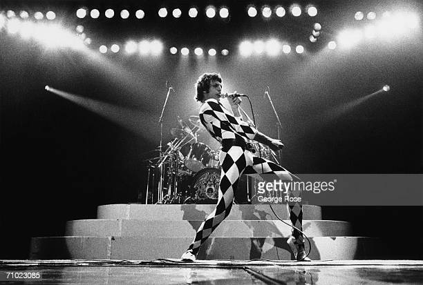 Singer Freddie Mercury of the rock group Queen prances onstage during a 1978 concert at the Great Western Forum in Inglewood California