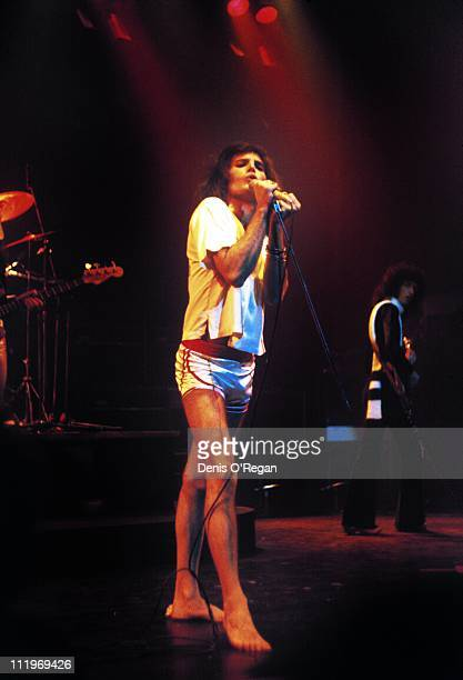 Singer Freddie Mercury performing with British rock group Queen at Hammersmith Odeon London 1975
