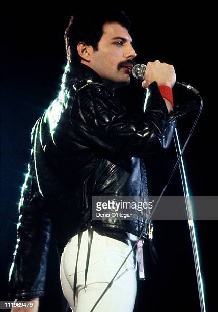 Singer Freddie Mercury performing with British rock group Queen at Wembley Arena London 1984