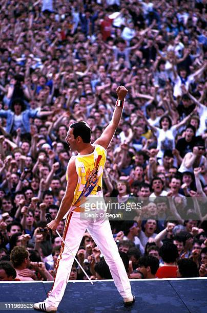 Singer Freddie Mercury performing with British rock group Queen at Slane Castle Ireland 1986