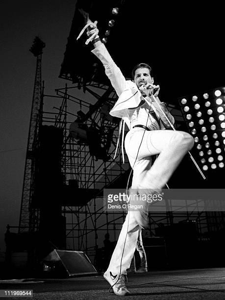 Singer Freddie Mercury performing with British rock group Queen at Milton Keynes 1982