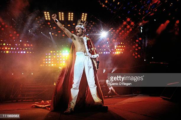 Singer Freddie Mercury performing with British rock group Queen at Wembley Stadium London during the Magic Tour July 1986 The band played two nights...