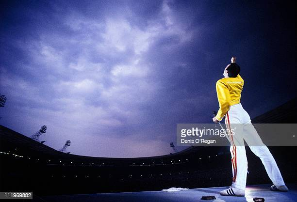 Singer Freddie Mercury performing with British rock group Queen at Wembley Stadium London 1986