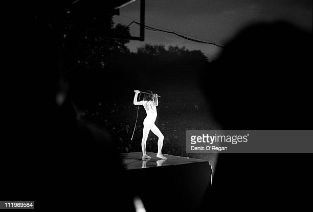 Singer Freddie Mercury performing with British rock group Queen in Hyde Park, London, 18th September 1976.