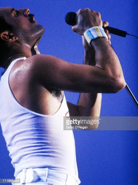 Singer Freddie Mercury performing with British rock group Queen on the 'Kind Of Magic' tour 1986
