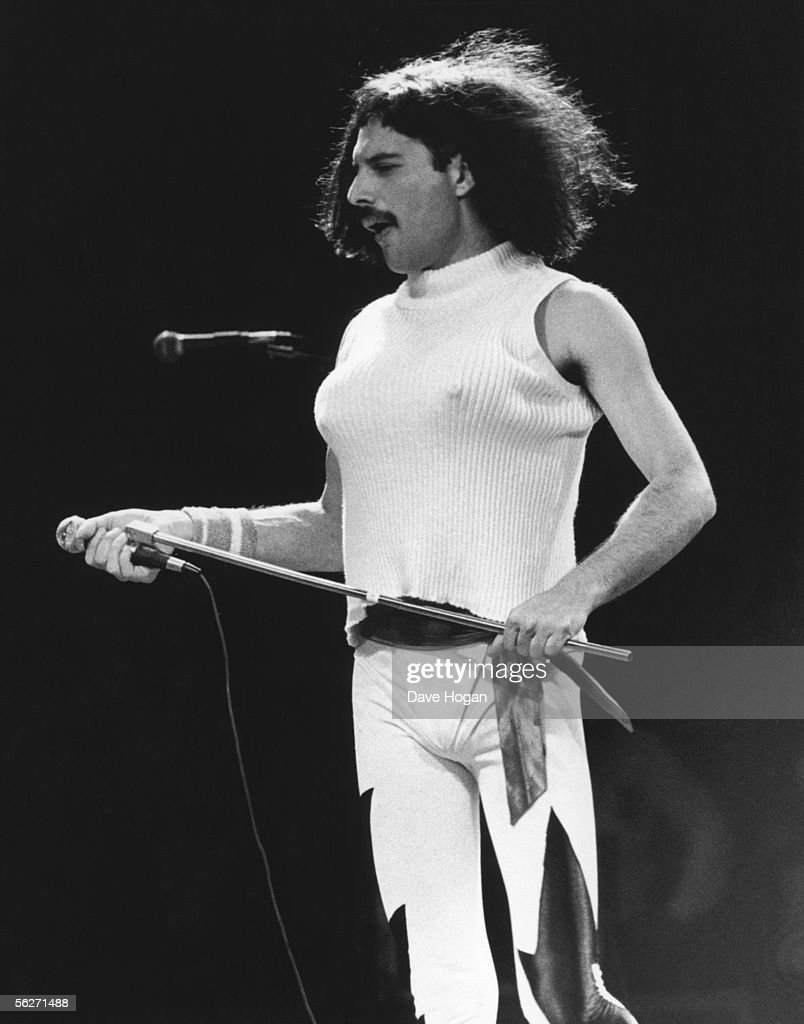 Singer Freddie Mercury performing with his group Queen at the inaugural Rock In Rio festival in Rio de Janerio, 24th January 1985. He is in drag wearing a wig and bra.