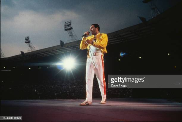 Singer Freddie Mercury performing with Queen at Wembley Stadium London July 1986 The band played two nights at the venue as part of the Magic Tour on...