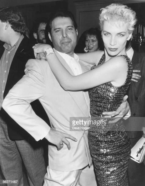 Singer Freddie Mercury with fellow performer Annie Lennox 21st April 1987 Mercury's group Queen had been presented with an Ivor Novello award marking...