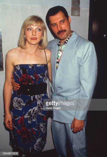Singer Freddie Mercury with his friend Mary Austin at an afterparty for Queen's Wembley concerts Kensington Roof Gardens London 12th July 1986