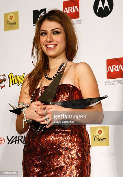Singer Gabiella Cilmi poses with her six ARIA Awards for Best Female Artist Breakthrough Artist Single Breakthrough Artist Album Best Pop Release...