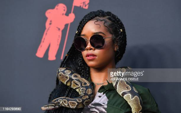 Singer Gabriella Wilson, aka H.E.R., arrives for the 2019 MTV Video Music Awards at the Prudential Center in Newark, New Jersey on August 26, 2019.