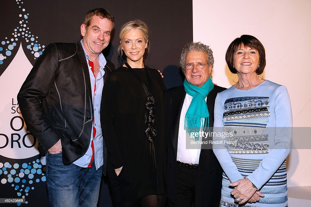 Singer Garou, CEO One Drop Catherine B. Bachand, CEO One Drop France Laurent Dassault and his wife Martine Dassault attend the 'One Drop' Gala, held at Cirque du Soleil on November 28, 2013 in Paris, France.