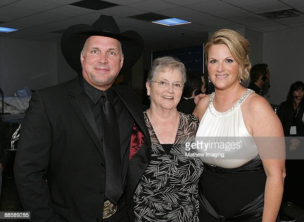 Singer Garth Brooks Gwen Yearwood and singer Trisha Yearwood and Tribackstage at the Hollywood Bowl Opening Night Gala held at the Hollywood Bowl on...