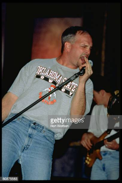 C/W singer Garth Brooks wearing Oklahoma State Cowboy tshirt performing