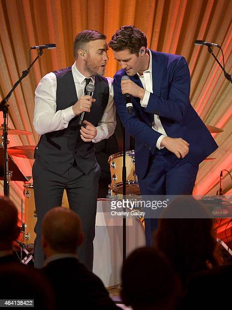Singer Gary Barlow and actor Matthew Morrison perform onstage during The Weinstein Company's Academy Awards Nominees Dinner in partnership with...