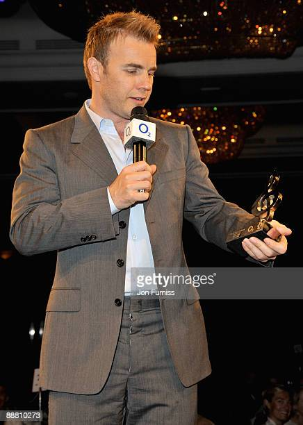 Singer Gary Barlow from Take That with their O2 Silver Clef award during the O2 Silver Clef Awards 2009 at the London Hilton on July 3 2009 in London...