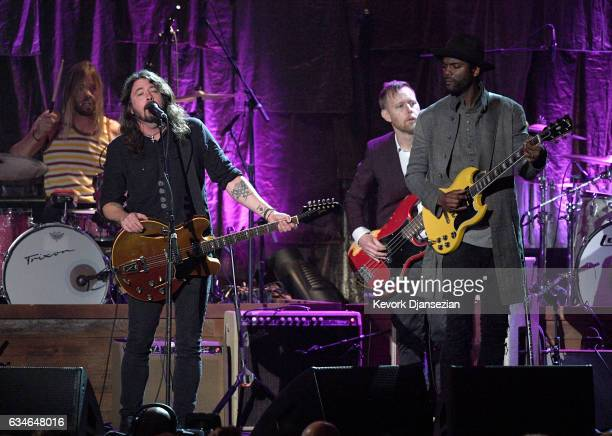 Singer Gary Clark Jr performs onstage with musicians Dave Grohl and Chris Shiflett of the Foo Fighters during MusiCares Person of the Year honoring...