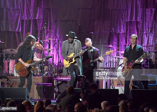 Singer Gary Clark Jr performs onstage with musicians Dave Grohl Chris Shiflett and Pat Smear of the Foo Fighters during MusiCares Person of the Year...