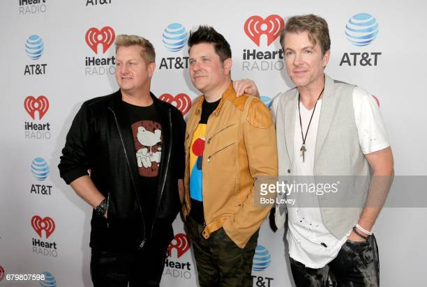 Singer Gary LeVox and musicians Jay DeMarcus and Joe Don Rooney of Rascal Flatts attend the 2017 iHeartCountry Festival A Music Experience by ATT at...