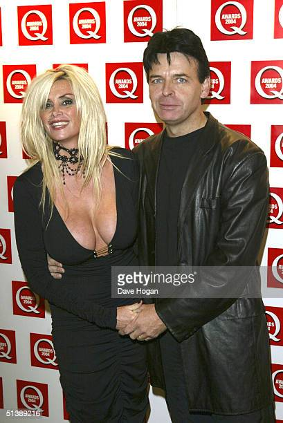Singer Gary Numan and his wife arrive for the Q Awards 2004 at Grosvenor House on Park Lane October 4 2004 in London England The 15th annual music...