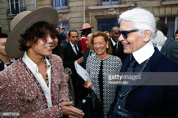 Singer GDragon Editor in Chief of Bunte and Fashion designer Karl Lagerfeld pose after the Chanel show as part of the Paris Fashion Week Womenswear...
