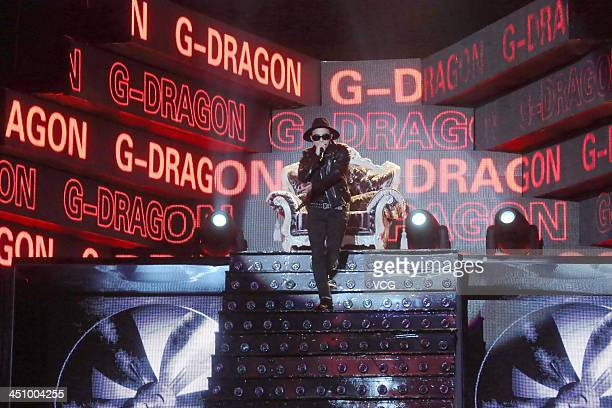 Singer GDragon of BigBang performs on the stage during the Young Choice 2013 Awards Ceremony at the National Olympic Sports Center on November 20...