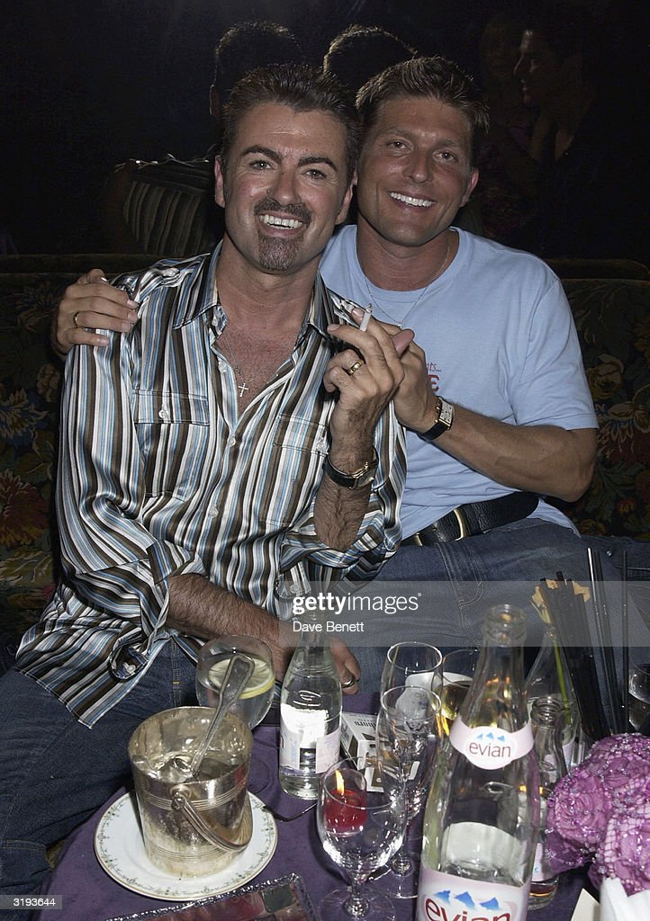 Singer, George Michael and partner Kenny Goss attend the Versace Couture Launch Party, thrown by Donatella Versace at The Ritz Hotel on 9th July 2002, in Paris. (Photo by Dave Benett/Getty Images).