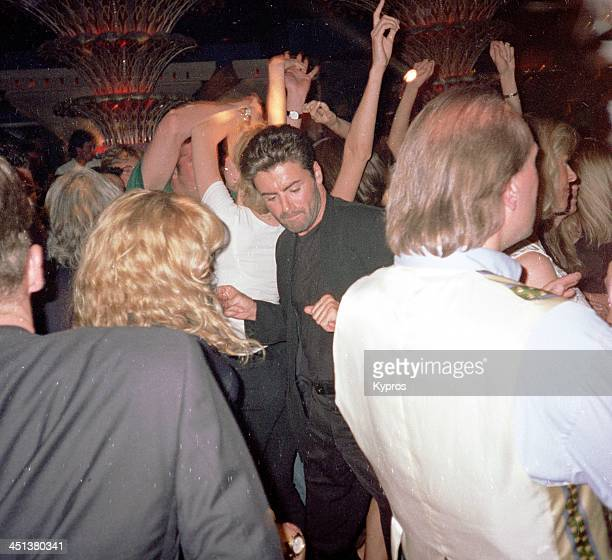 Singer George Michael dancing at a nightclub in Saint Tropez France 1990s