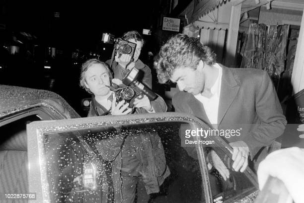 Singer George Michael is photographed by photographer Alan Davidson as he gets into a car in central London August 1989