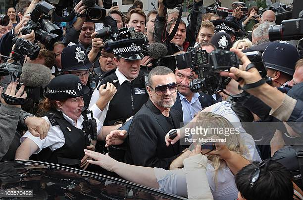 Singer George Michael leaves Highbury Corner Magistrates Court surrounded by press and police on August 24 2010 in London England Mr Michael pleaded...