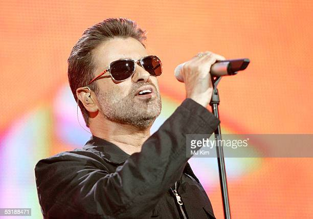 "Singer George Michael performs on stage at ""Live 8 London"" in Hyde Park on July 2, 2005 in London, England. The free concert is one of ten..."
