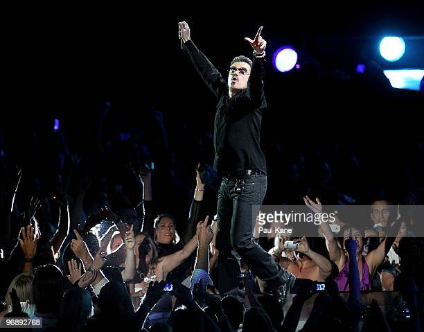 """Singer George Michael performs on stage in concert on the first night of his """"George Michael Live"""" Australian tour at Burswood Dome on February 20,..."""