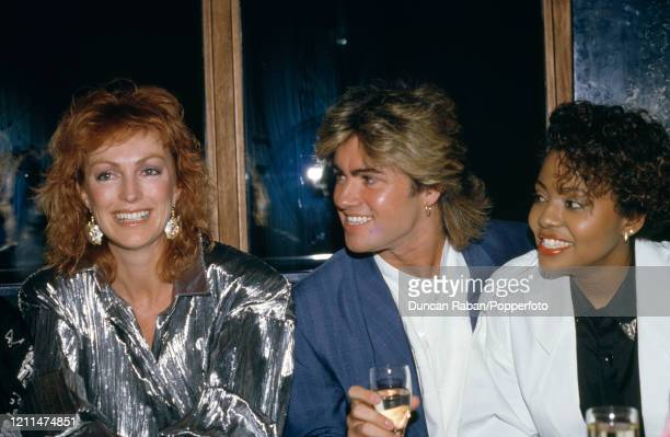 Singer George Michael with his girlfriend Pat Fernandez and David Cassidy's wife Meryl Tanz after the premiere of the film Number One in London...