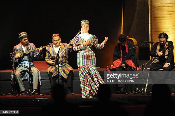A singer gestures as musicians play during the opening ceremony of the 18th World Sacred Music Festival in Fes on June 8 2012 They are taking part to...