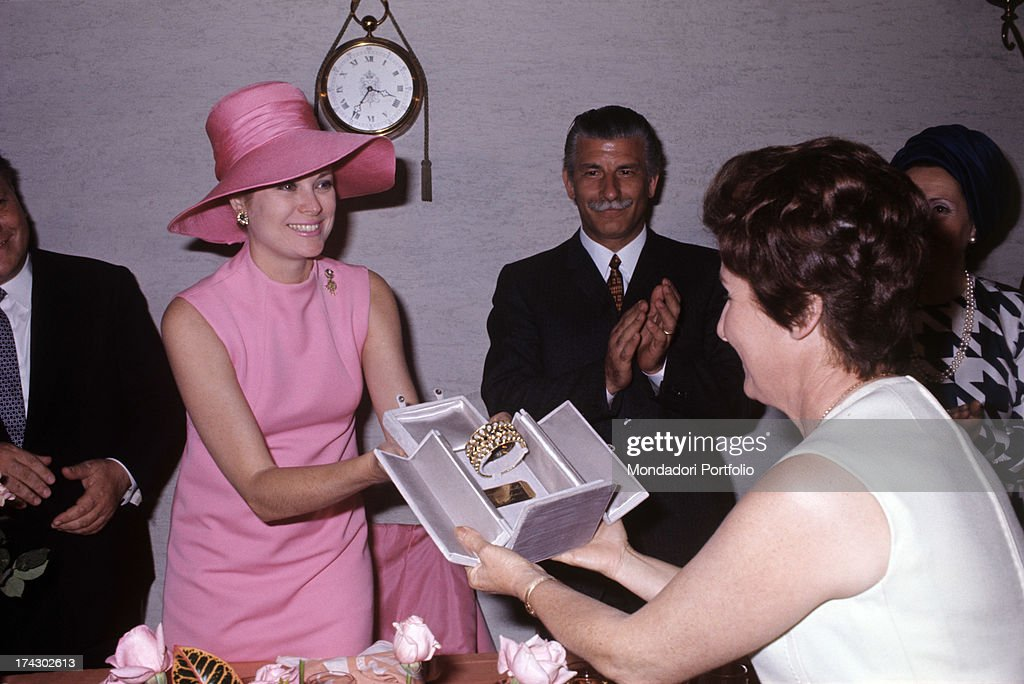 Grace Kelly Receives A Prize From The Hands Of Female Organiser : News Photo