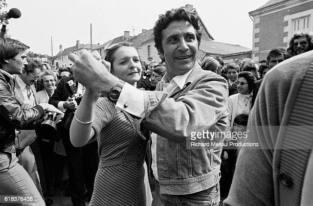 Singer Gilbert Becaud Dances with a Young Woman