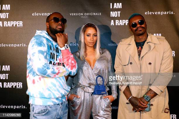 Singer Gims his wife Demdem and Football player Djibril Cisse attend the I am not a Rapper Capsule Collection Launch Party Photocall on April 11 2019...