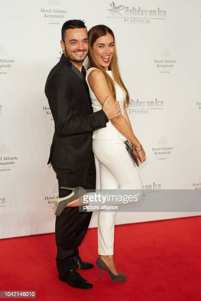 Singer Giovanni Zarrella and his wife Jana Ina pose on the red carpet during the Holiday on Ice birthday gala at Hotel Altantic Kempinski in Hamburg...