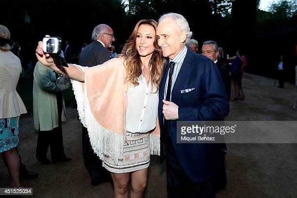 Singer Gisela and Josep Carreras take a selfie while attending a Tom Jones concert during the second 'Festival Jardins de Pedralbes' on June 30 2014...