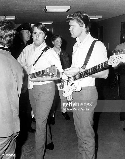 """Singer Glen Campbell and guitarist Carl Wilson of the rock and roll band """"The Beach Boys"""" waiting backstage for a performance in 1965. Campbell..."""
