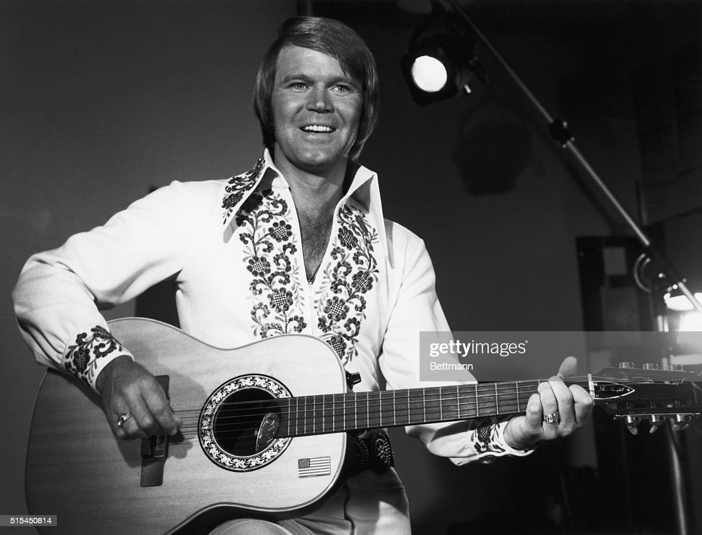 Singer Glen Campbell playing guitar as host of the NBC television show The Midnight Special episode which was broadcast on October 24, 1975 after The Tonight Show Starring Johnny Carson.