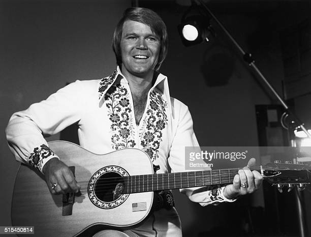 Singer Glen Campbell playing guitar as host of the NBC television show The Midnight Special episode which was broadcast on October 24 1975 after The...