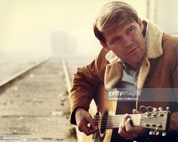 Singer Glen Campbell poses for a portrait playing a Martin acoustic guitar in 1967 Photo by