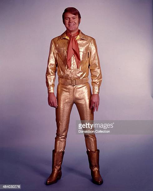 Singer Glen Campbell poses for a portrait wearing a gold suit in circa 1967. (Photo by