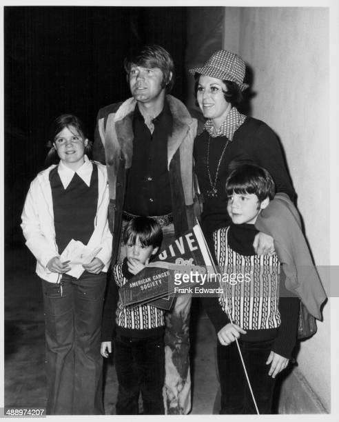 Singer Glen Campbell with his children Kelli Travis and Kane attending a charity basket ball game in Beverley Hill California February 3rd 1973