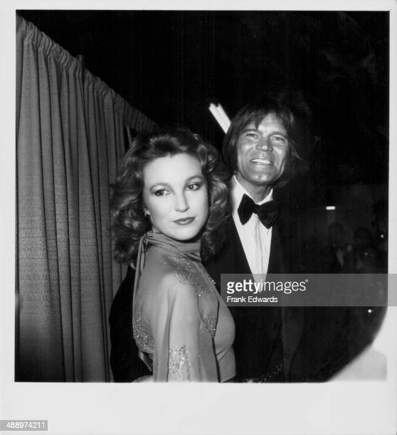 Singer Glen Campbell with his girlfriend country singer Tanya Tucker attending the 21st Grammy Awards at the Shrine Auditorium Los Angeles California...